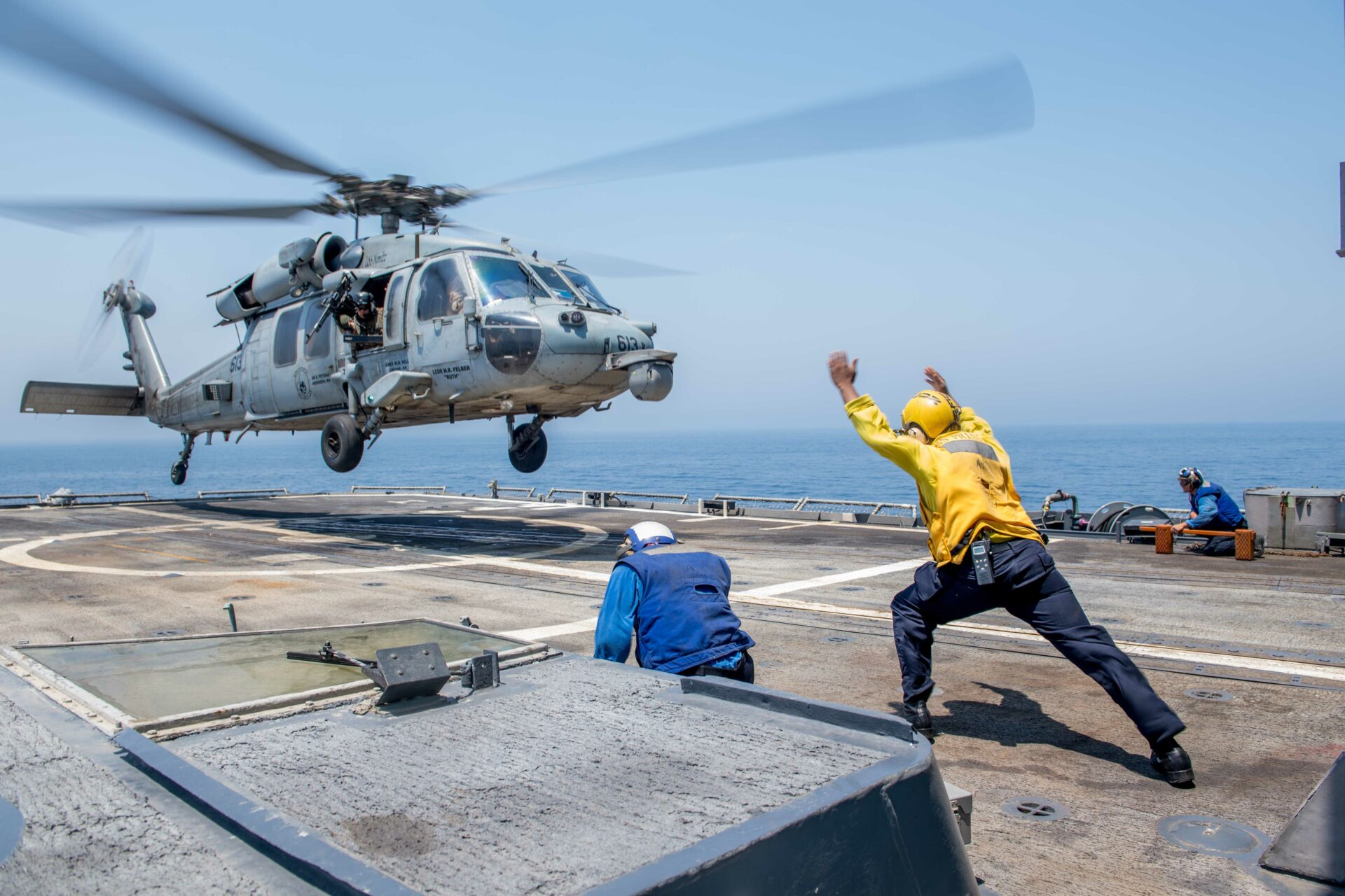 "170805-N-VR594-0287 ARABIAN GULF (Aug. 5, 2017) Rear Adm. Bill Byrne, commander of Carrier Strike Group 11, departs the Ticonderoga-class guided-missile cruiser USS Princeton (CG 59) on an MH-60S Sea Hawk helicopter assigned to the ""Eightballers"" of Helicopter Combatant Strike Squadron (HSC) 8. Princeton is deployed to the U.S. 5th Fleet area of operations in support of maritime security operations designed to reassure allies and partners, and preserve the freedom of navigation and the free flow of commerce in the region. (U.S. Navy photo by Mass Communication Specialist 3rd Class Kelsey J. Hockenberger/Released)"